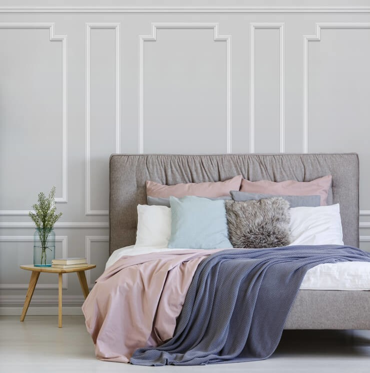 off-white panel wallpaper in bedroom with pink and white bed