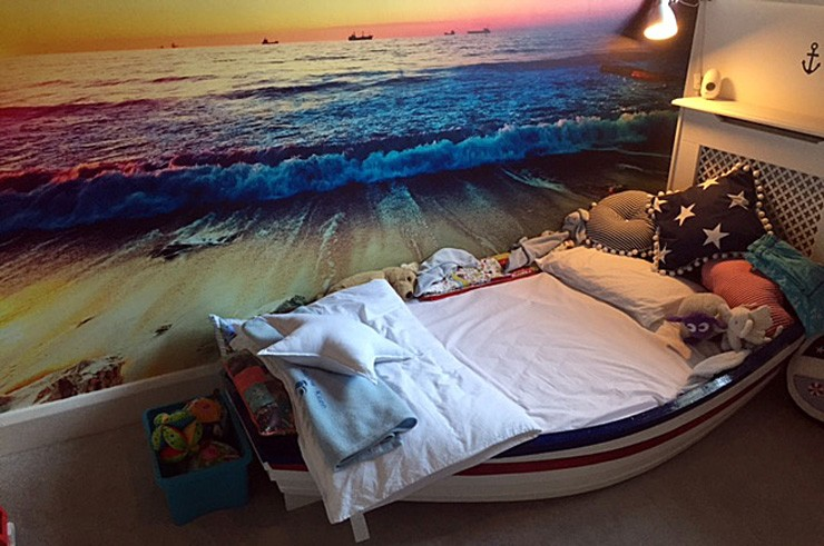 ocean sunset mural in bedroom