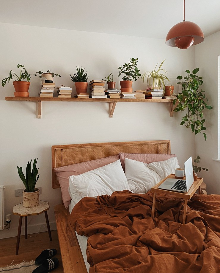 white and terracotta boho bedroom with green plants