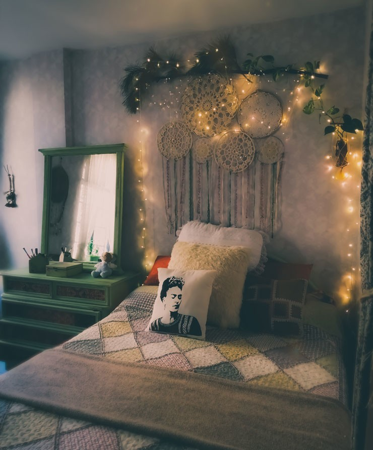 dark country bedroom with dream catchers, greenery and fairy lights