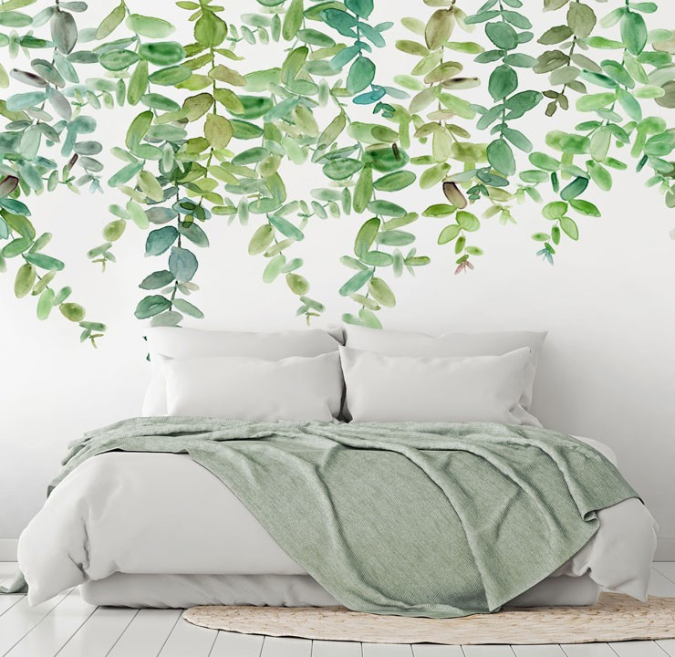 painted green leaves hanging on white background wallpaper in relaxing bedroom