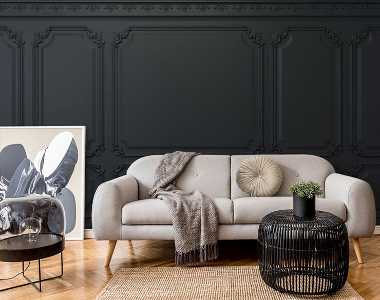 vintage ornate black panel wallpaper in trendy lounge with grey and beige accessories