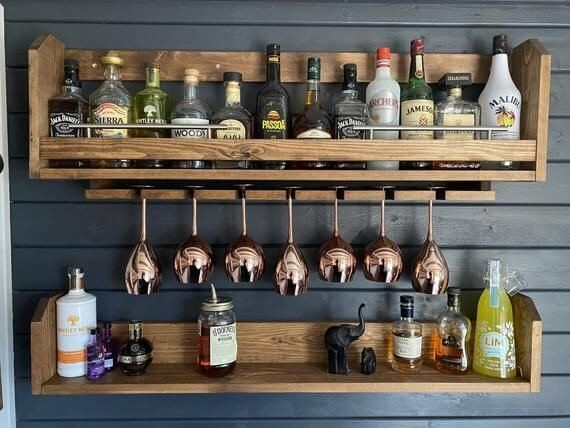 summer house bar shelves on navy painted wall