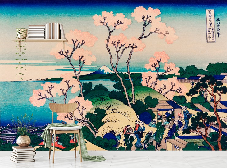japanese painting of people on mountain top with blossom tree and ocean wallpaper in room with a single wooden chair
