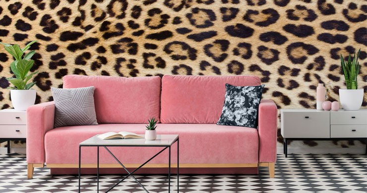 jaguar print wallpaper with hot pink sofa and patterned decor