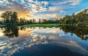 Wide Angle River Clouds Reflection wall mural thumbnail