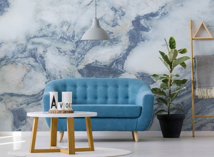blue sofa with blue and white marble feature wall