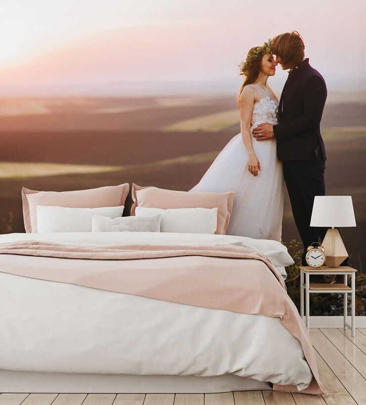 photo of married couple statement wallpaper in bedroom with pink and white bed