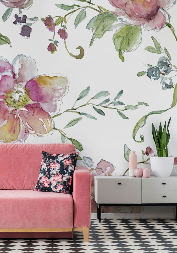 floral wall mural in living room with pink sofa