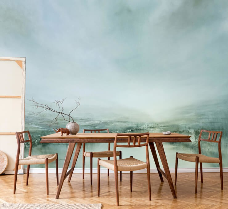 very pale green abstract landscape painting wallpaper in dining room with sleek wooden table and chairs