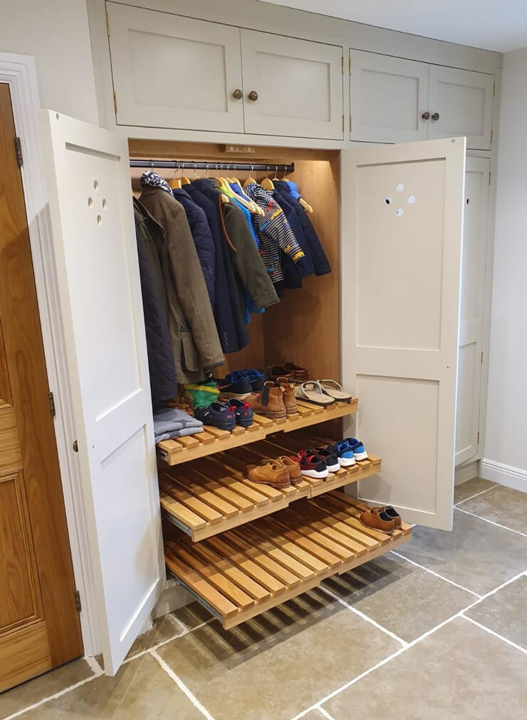 white and wood shoe sliding storage