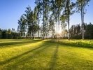 Sunset on golf course in Poalnd wall mural thumbnail
