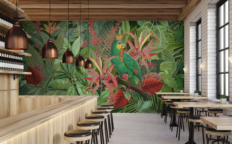 illustrated parrot wearing crown in green and pink jungle wall mural in industrial trendy restaurant
