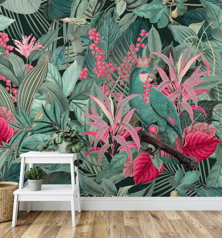 dark green and pink jungle illustration with parrot wearing crown wall mural in room with white ladder shelf