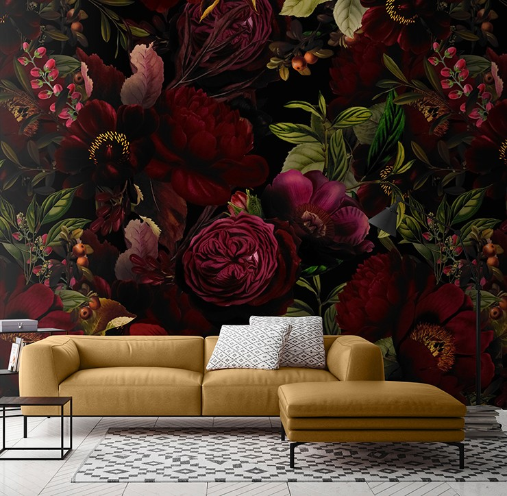 maroon coloured dark flowers in living room with mustard-yellow sofa