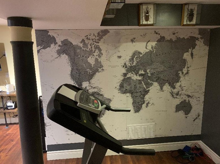grey illustrated world map in home gym with wall divider