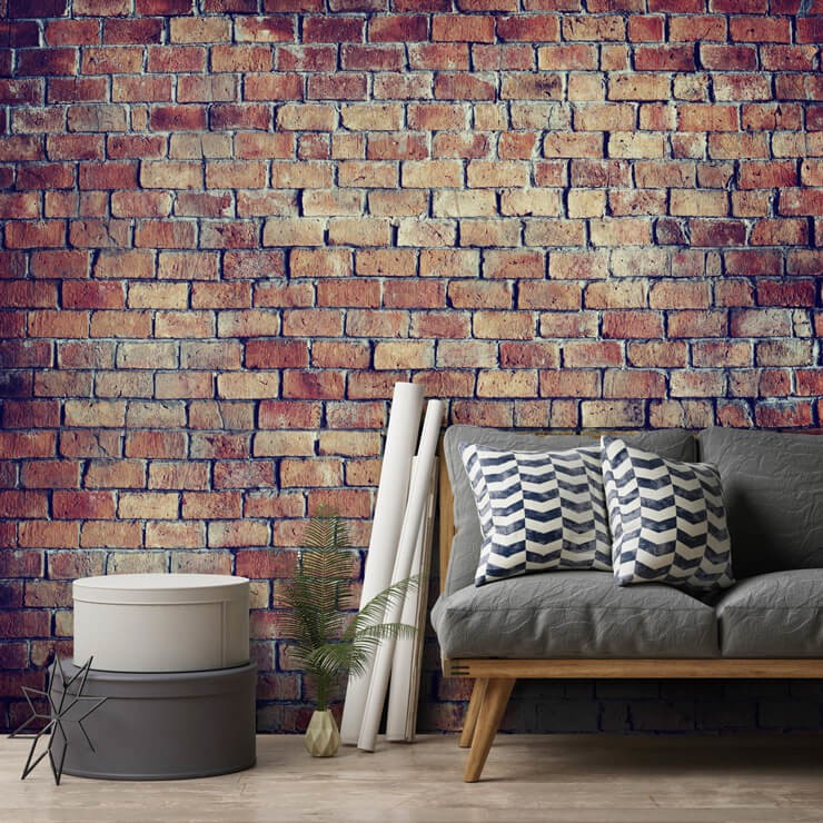 red brick effect wallpaper in lounge with grey couch