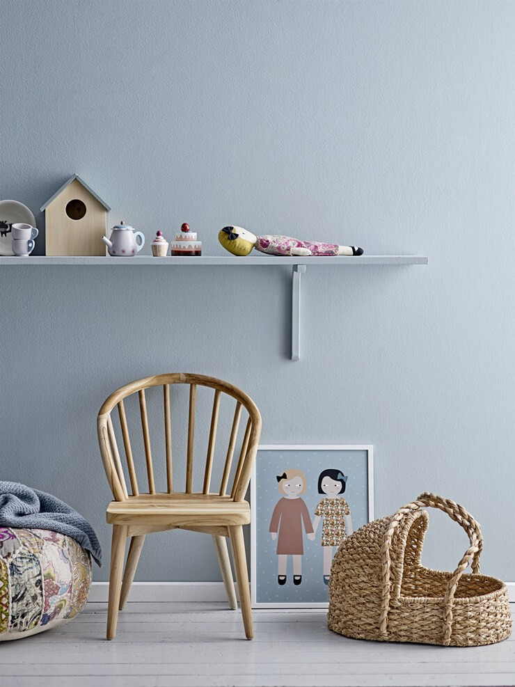grey painted nursery with shelf and wicker moses basket