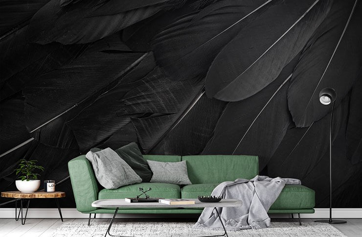 enlarged black raven feather wallpaper in lounge with green couch and black accessories