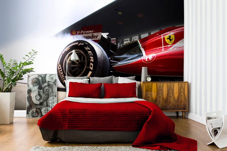 red ferrari car in motion with close up of wheel wallpaper in bedroom with red bed