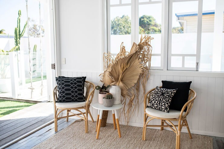 bamboo chairs in white summer house interior design setting