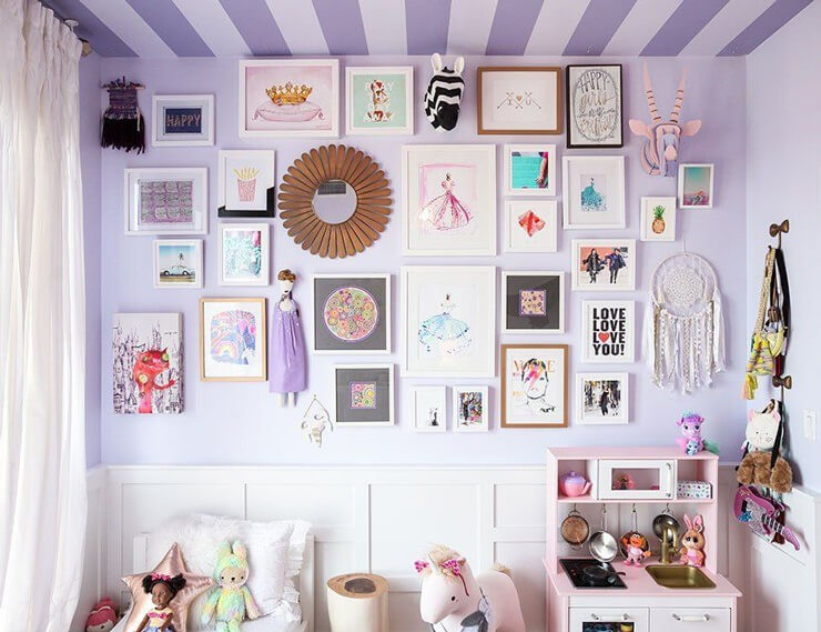 purple bedroom wall with white frames fun, girly prints