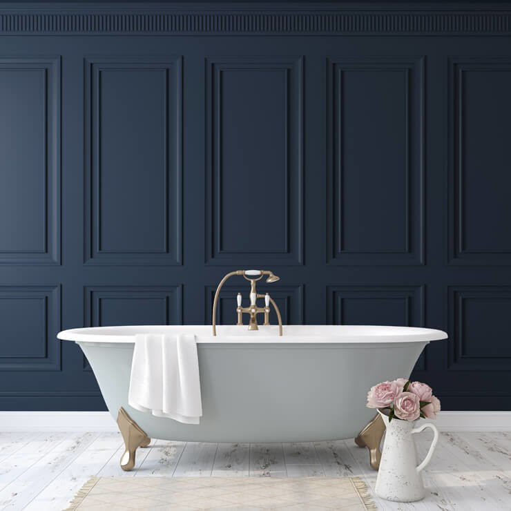 navy-blue wood panel wallpaper in bathroom with free standing grey and white bath