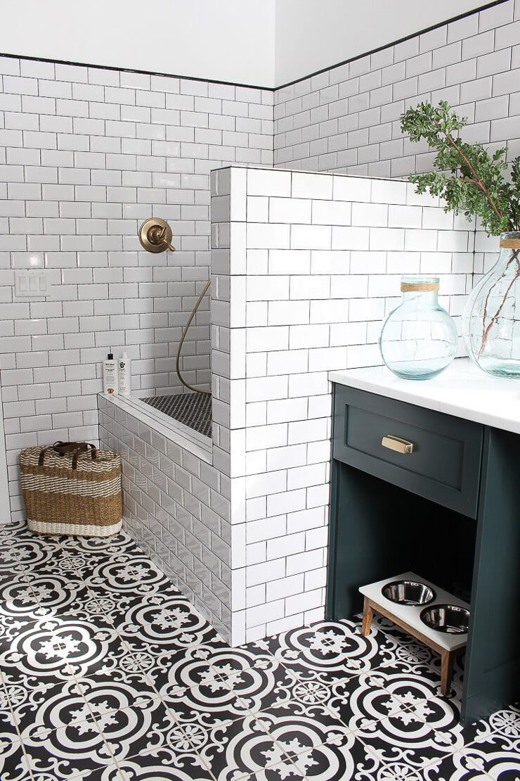 white tiled modern mudroom with dog shower