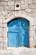 Wooden blue door in Madaba mural wallpaper thumbnail