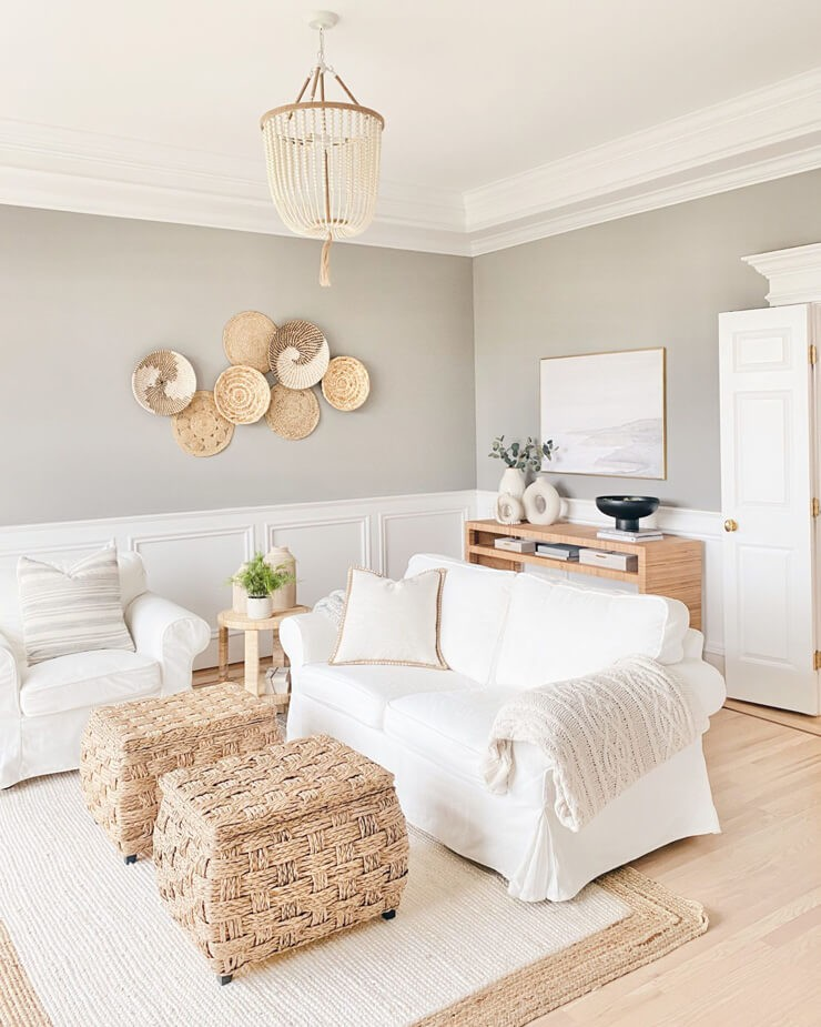 greige painted walls in living room with white panelling and white couch