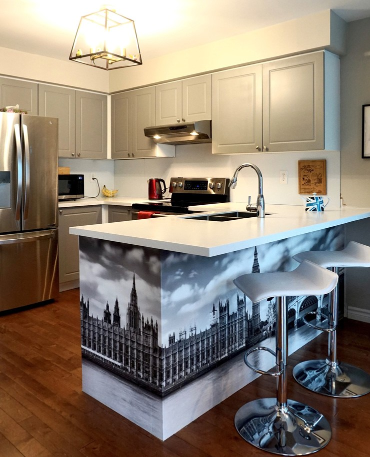 grey and white kitchen with houses of parliament black and white wallpaper on breakfast bar