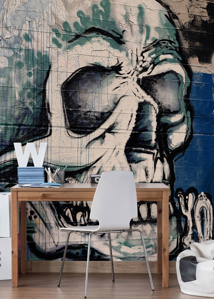 blue, white and black skull graffiti wall mural in teenage boy's desk area