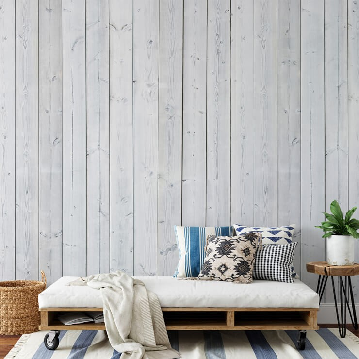 white panel wall mural in summer house with pallet chair