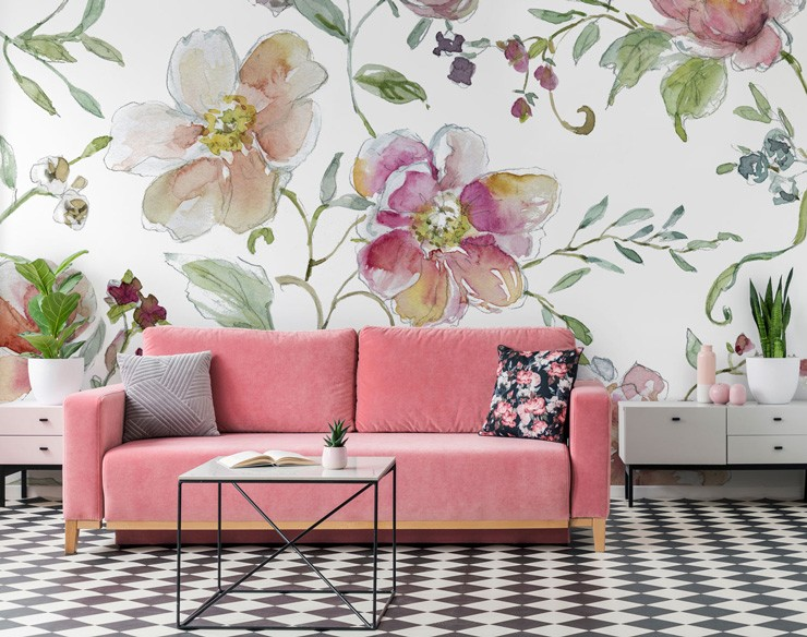 white background and large pink floral pattern in lounge with bright pink sofa and black and white tiled floor