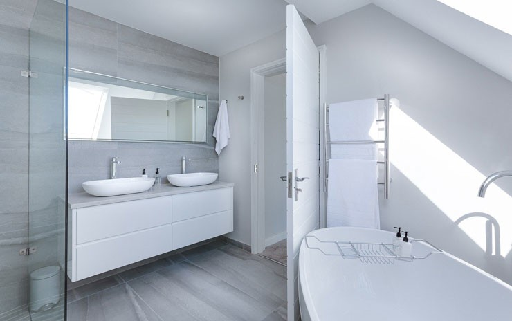 white bathroom with stand alone tub and walk in shower