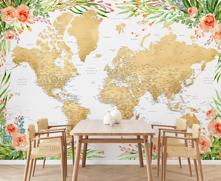 golden coloured map with leafy green and pink painted floral boarder