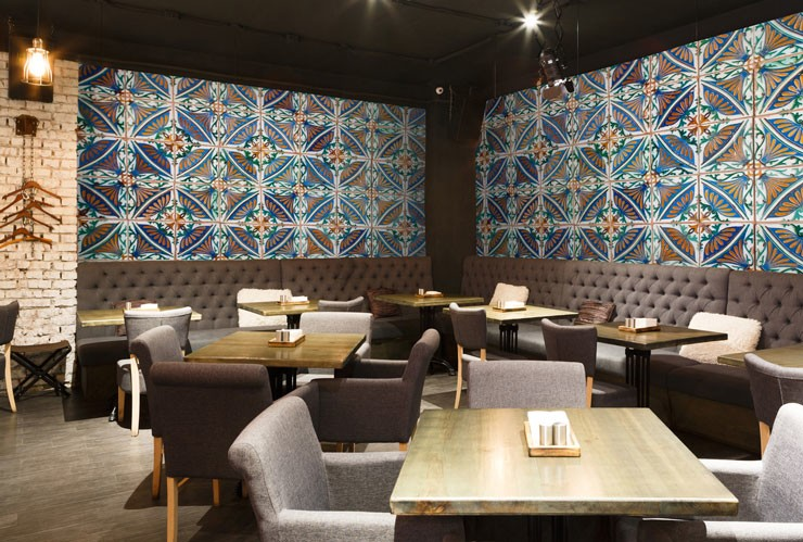 blue and white turkish geometric tiles in stylish basement restaurant