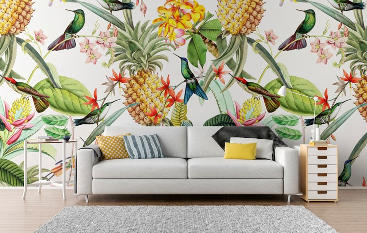 colourful bird and pineapple illustrated wallpaper in light lounge