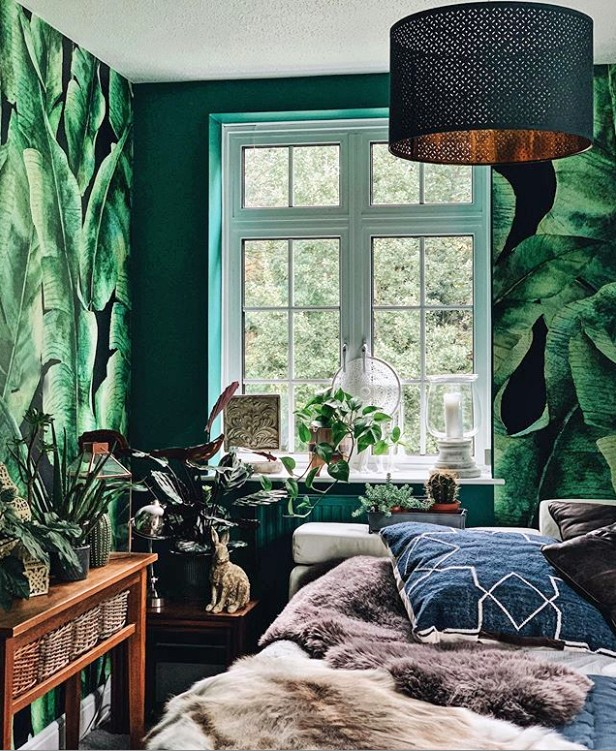 dark palm leaf wallpaper in bedroom with maximalist decor