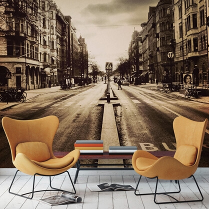 sepia cityscape wallpaper in living room with yellow chairs