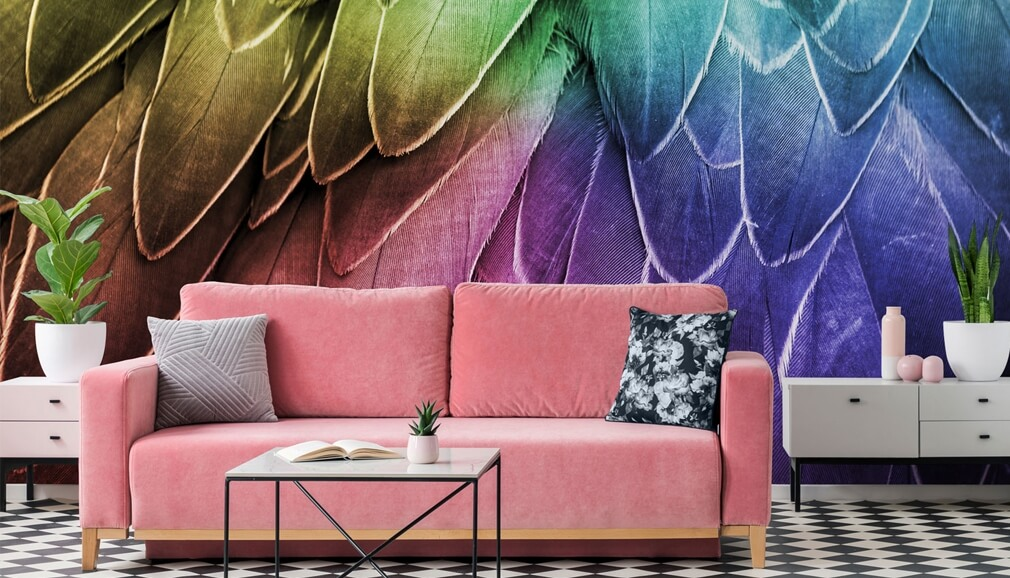 multicoloured wallpaper in living room with pink sofa