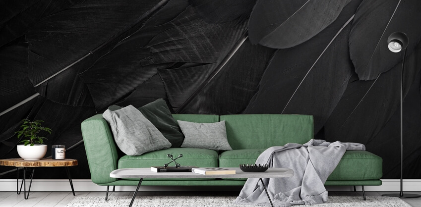 dark wallpaper in living room with green sofa